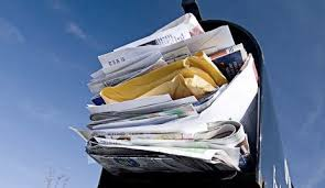 overflowing snail mail box